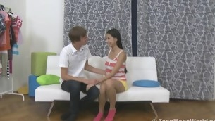 Pleasing legal age teenager rides a penis on a white sofa