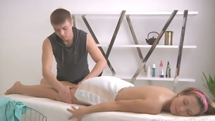 Powered massage therapist makes sure a cool ass is oiled up